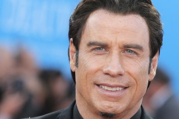 """John Travolta poses as he arrives for the screening of """"Killing Season"""", Friday, Sept. 6 , 2013, at the 39th American Film Festival, in Deauville, Normandy, western France. (AP Photo/Lionel Cironneau)"""