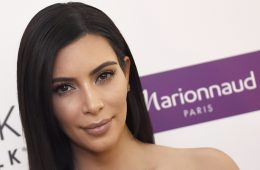 US reality TV star Kim Kardashian poses while presenting a product of her new comestic brand during a photocall, on April 15, 2015 in Paris.    AFP PHOTO / LOIC VENANCE        (Photo credit should read LOIC VENANCE/AFP/Getty Images)
